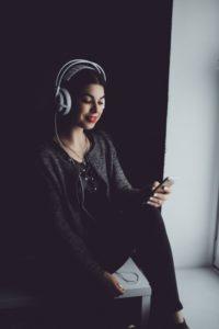 Girl Listening to Audiobooks
