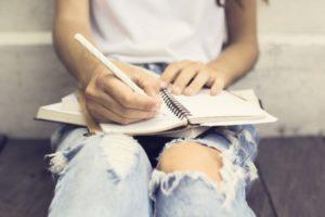 Teen Taking Notes