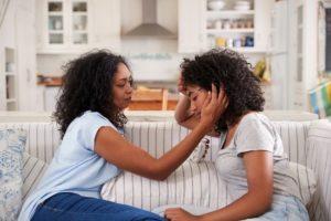 parents comforting teens